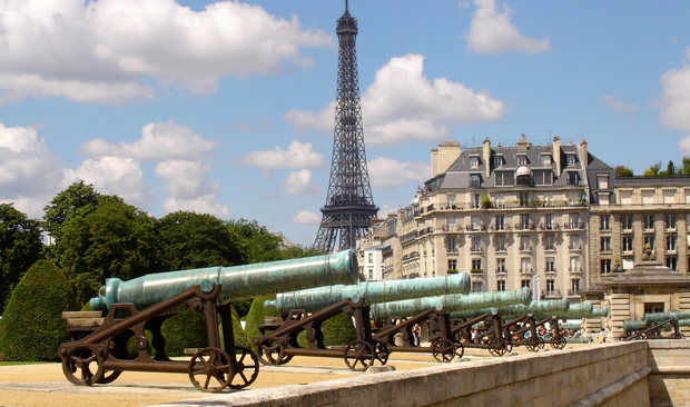 Cannons outside Paris Palace des Invalides and the Eiffel Tower