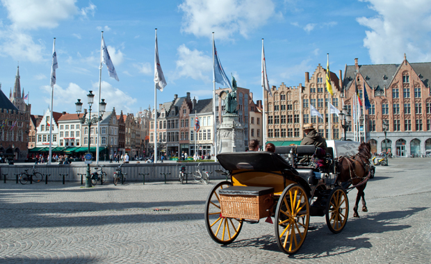 Horse-drawn carts in Bruges' Grote Markt
