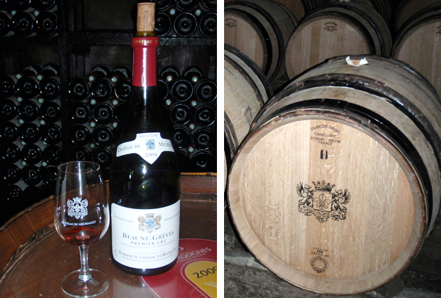 Wine glass and barrels on a cellar tasting in Beaune