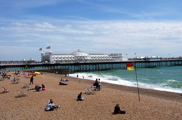 Summer at Brighton beach and pier in Sussex, England