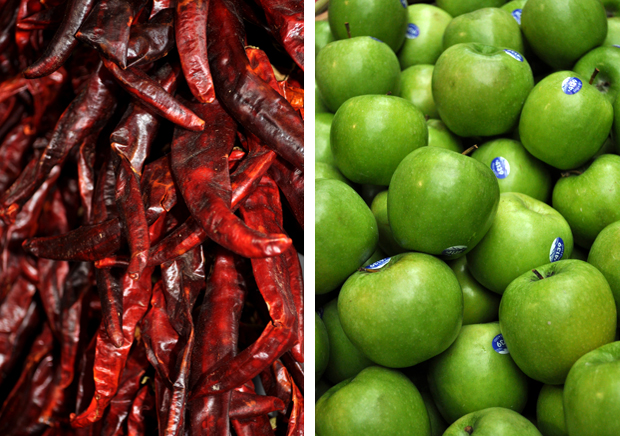 Colourful chillis and apples on stalls at Borough Market in London