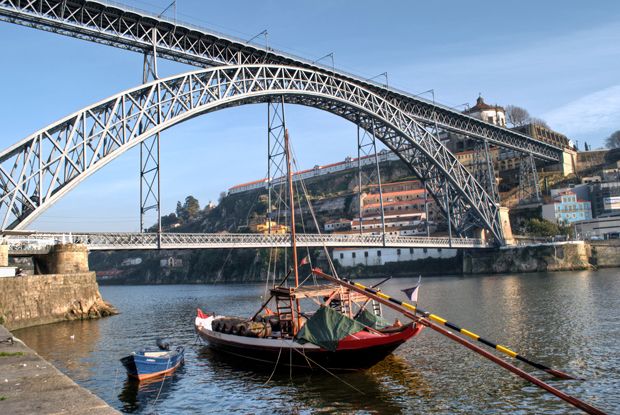 Port barge under the Dom Luis Bridge, Porto, Portugal