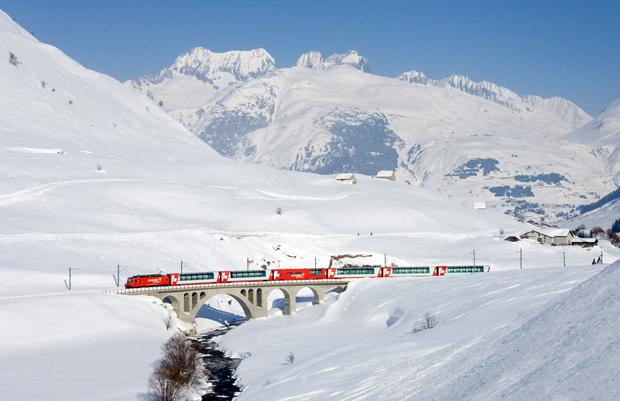 The Glacier Express scenic mountain train in the snow